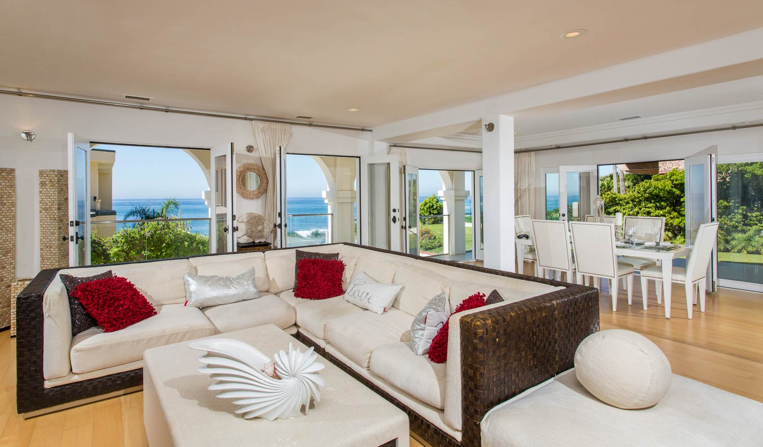 The home features French doors throughout to showcase the exceptional ocean views and create an open and airy feeling.