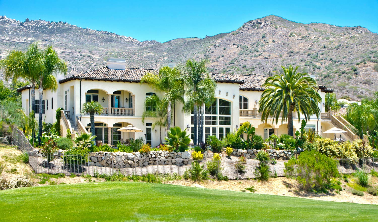 An entertainer's dream home, this 7 bedrooom, 8 bath sprawling property offers stunning views of the Maderas Golf Course and has a billiards room, theater area, wine tasting cellar, and even an elevator.