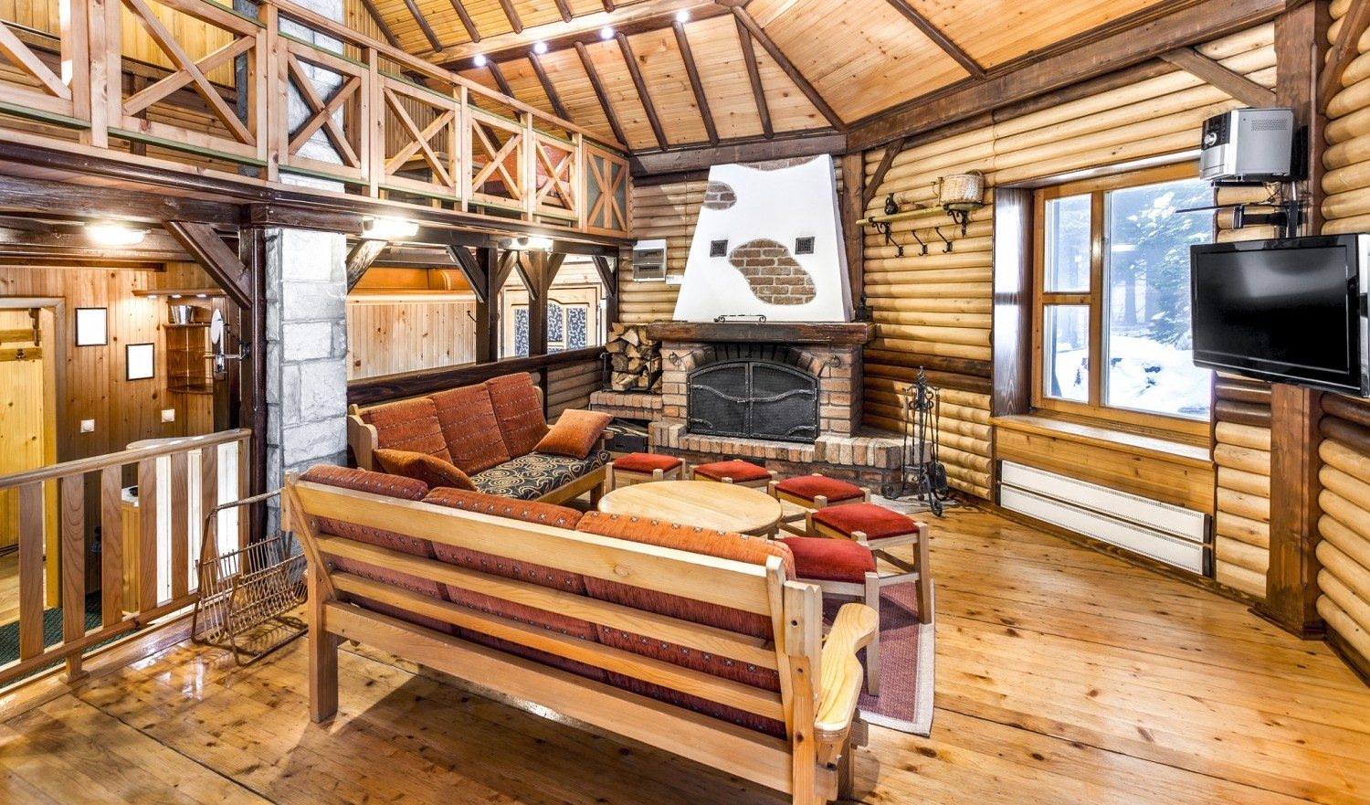 Traditional wooden interior with table and fixtures - mountain resort