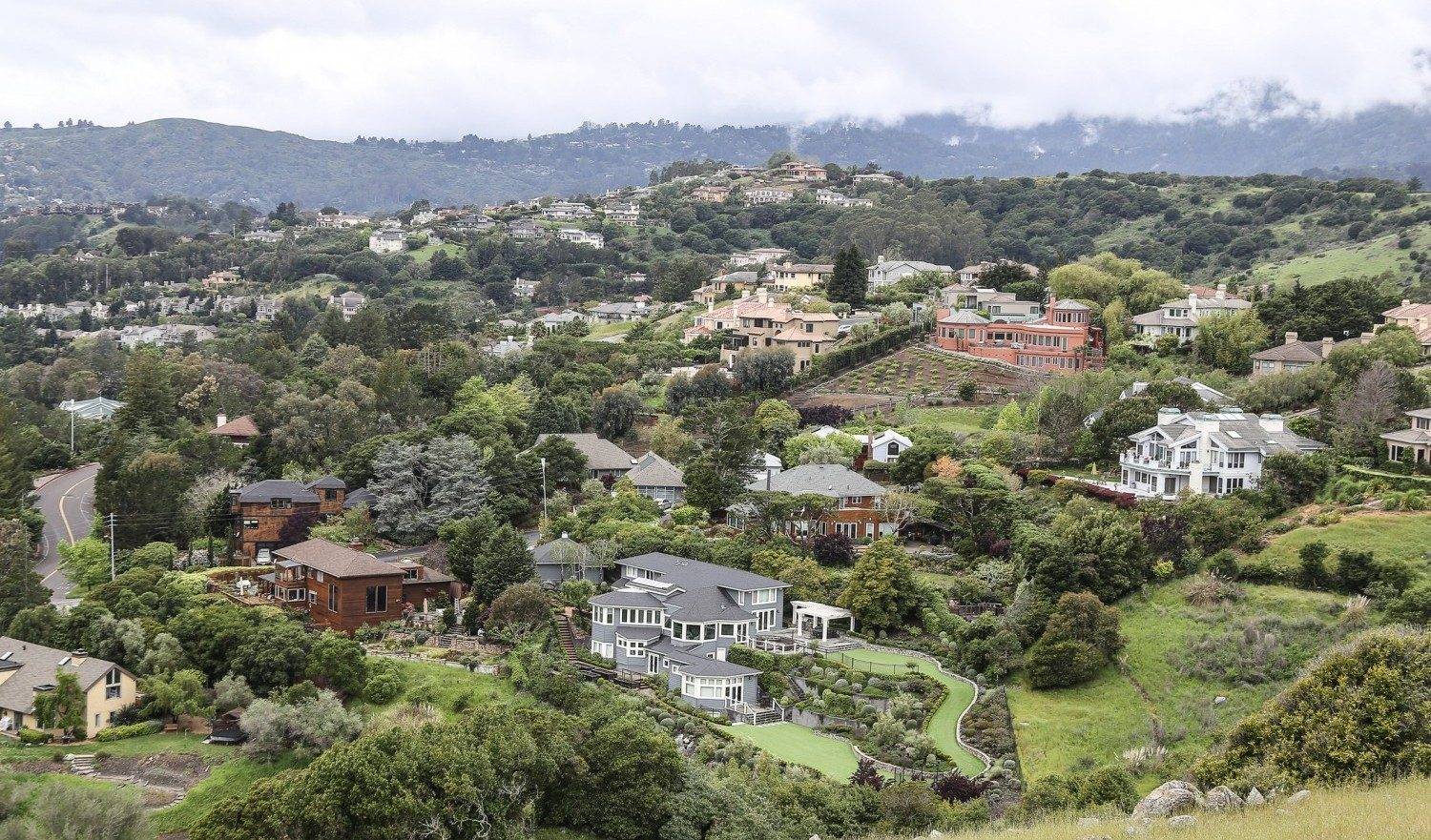View from the Tiburon Open Space Preserve in Marin County. The views show some of the homes in West Tiburon. Tiburon is an incorporated town in Marin County, California. It is located on the Tiburon Peninsula, which reaches south into the San Francisco Bay.