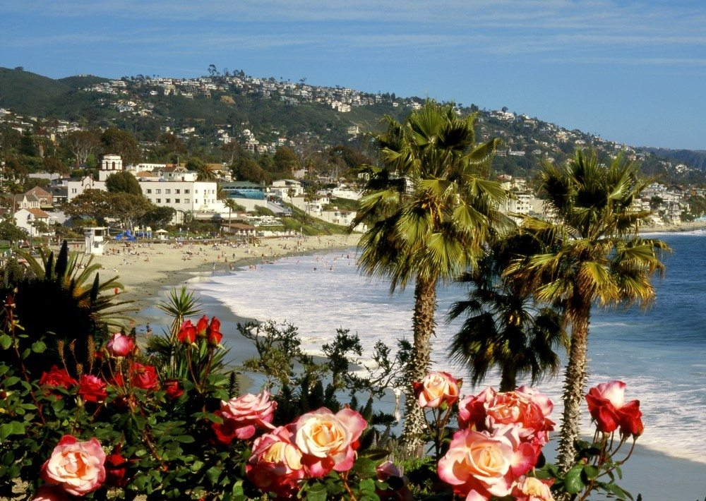 View of Main Beach Park at  Laguna Beach, California in Springtime, This view is from Heisler Park looking the south across the Rose Gardens. Laguna is a famous art colony and popular tourist town.