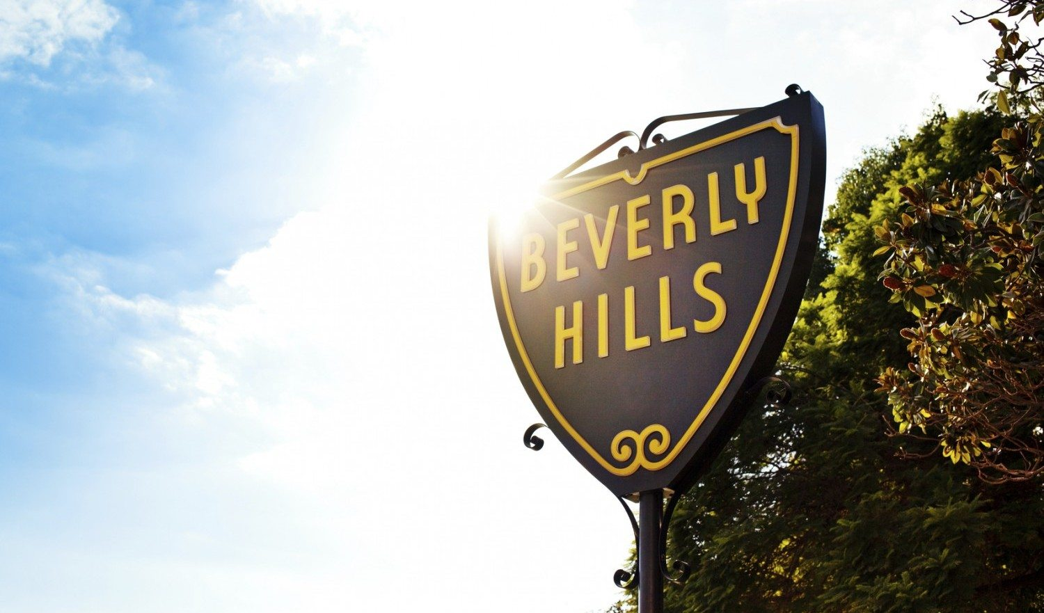 Beverly Hills, CA, USA - October 21, 2012: Sun shining behind the Beverly Hills Sign on a fall afternoon.